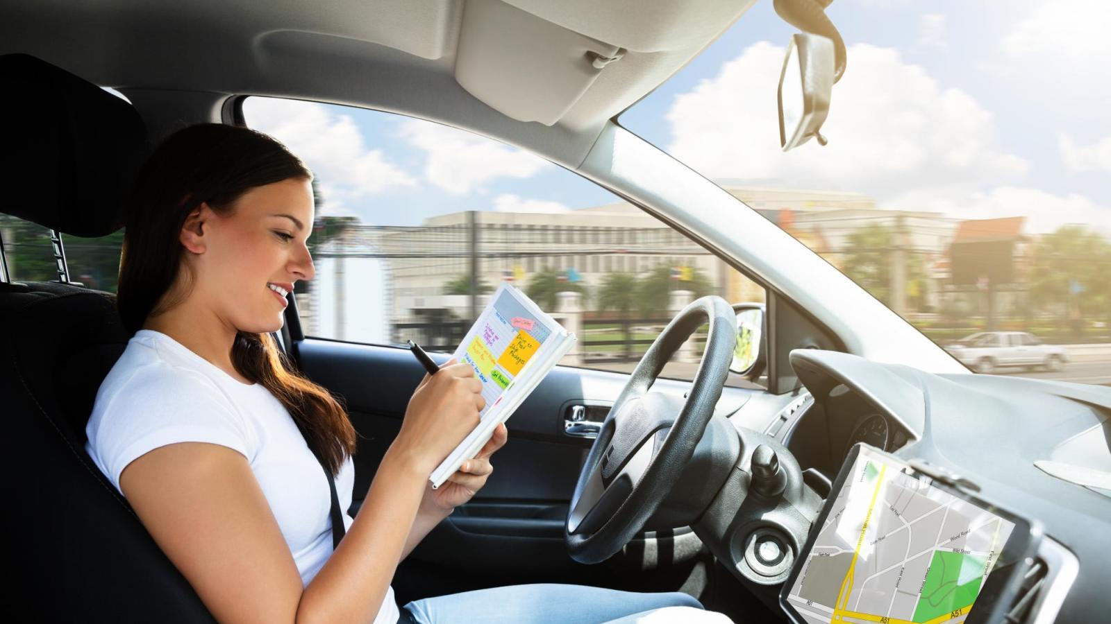 A woman in an autonomous car