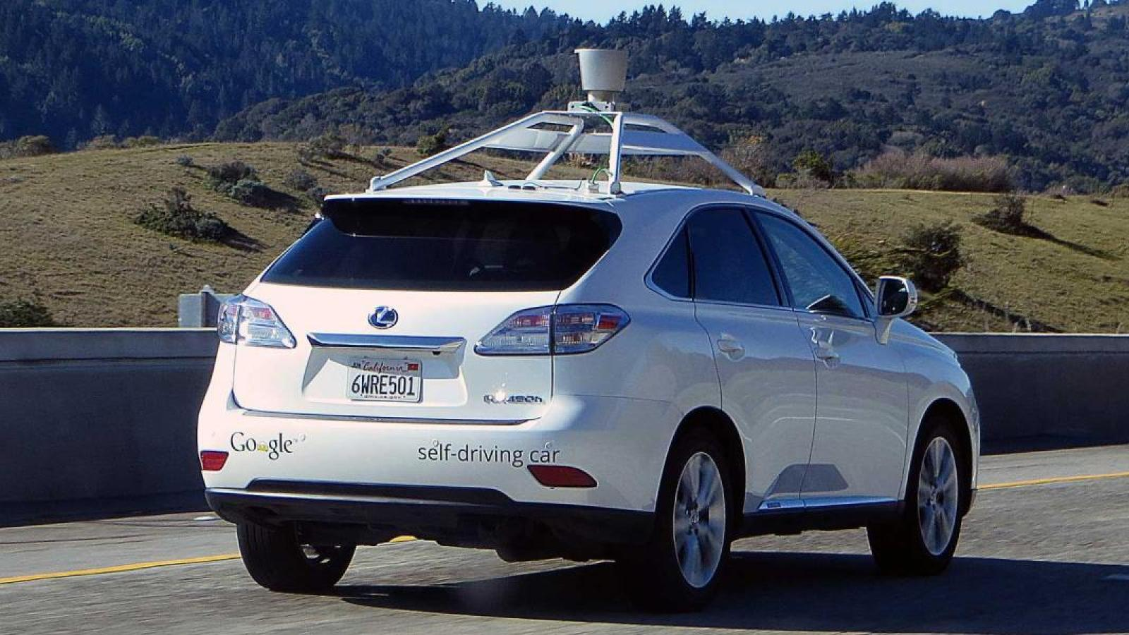 A Google self-driving car with lidar on top, cruising the interstate in California.