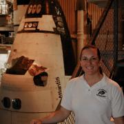 Kirk next to a shuttle craft in a hanger
