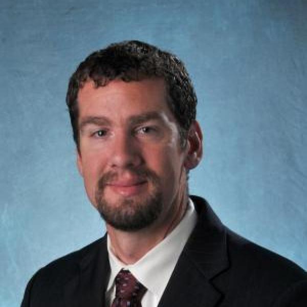Mark Borden portrait on blue background