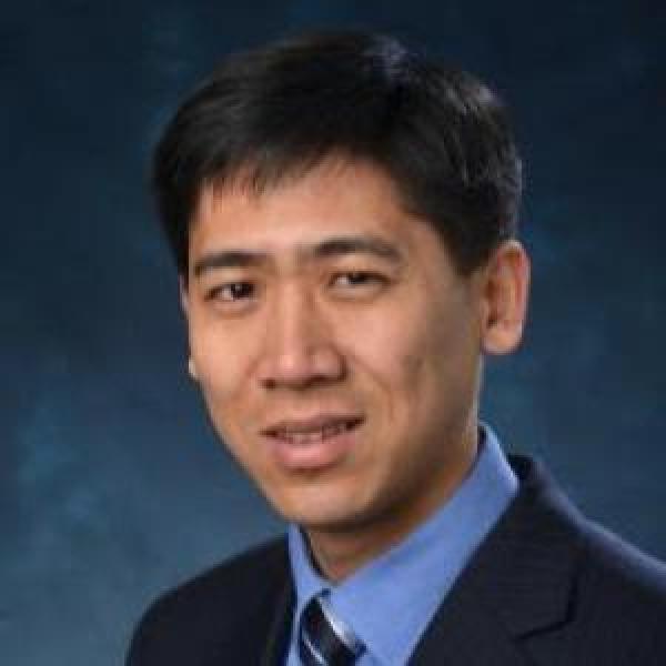Zhiyong Jason Ren portrait on a blue background