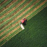 A farmer's tractor plowing a field