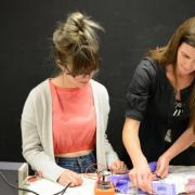 Laura Devendorf working with a student