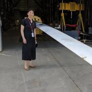 Lucy Pao standing in front of the wind turbine blade