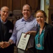Tim white at the conference with his award