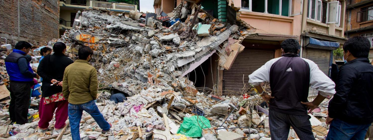 Citizens looking at the destruction from an earthquake