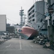 tsunami aftermath boat in road
