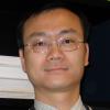 A close up headshot of John Zhai