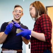 Wil Srubar working in the lab with a student.