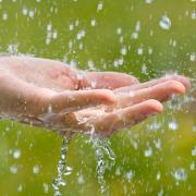 rainwater hitting a hand