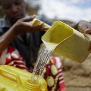 Water being poured into a bucket in Africa.