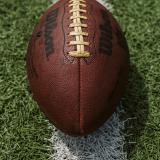 a football lying in the grass thumbnail