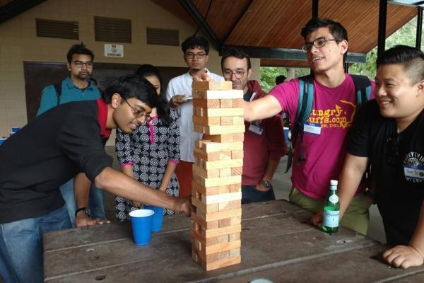 Students playing jenga