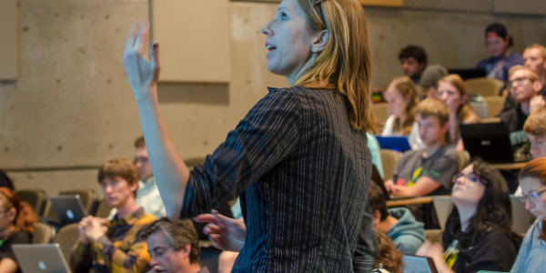 teacher in front of a large full lecture hall