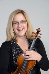 Headshot of Cookie Segelstein holding a violin or viola and bow