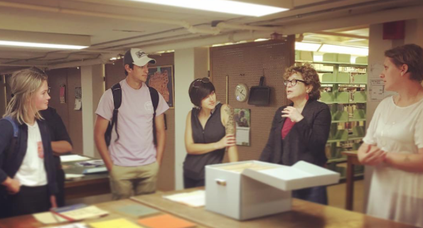 Undergraduate and Graduate students touring the Post-Holocaust American Judaism Collections with Professor Nan Goodman