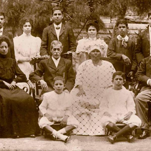 Fernandesfamily, Suriname ca. 1908. At center are Isaac Daniel Fernandes, a Portuguese Jew from a planter family, and Klasina Elisabeth Vroom, descended from a family of manumitted slaves. Surrounding them are their eight children and a daughter-in-law. Courtesy of the Fernandes-Vroom family.