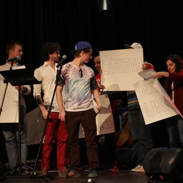 Students performing in both Hebrew and Arabic
