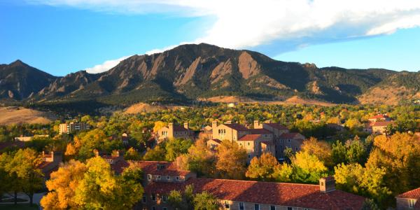 Ariel view of the University of Colorado Boulder campus and the Flatirons during fall
