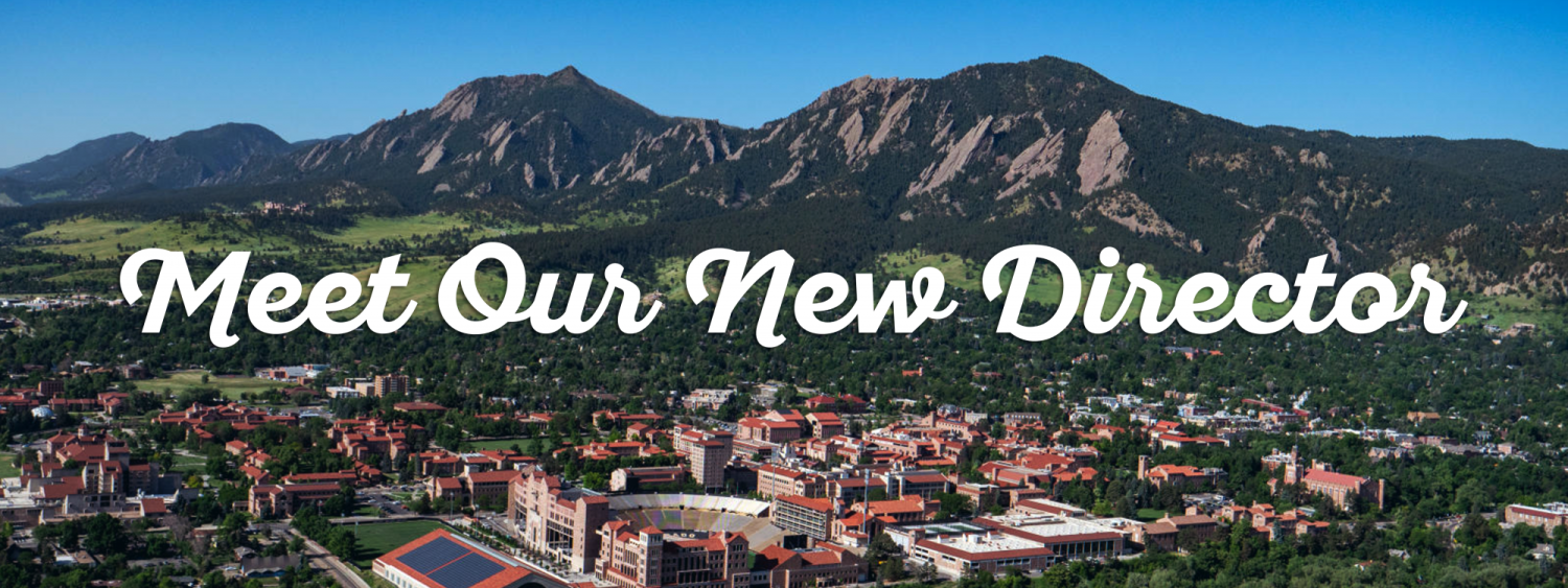 """Bold white text reads """"Meet Our New Director"""" over an aerial shot of the CU Boulder campus with the Flatirons in the background."""