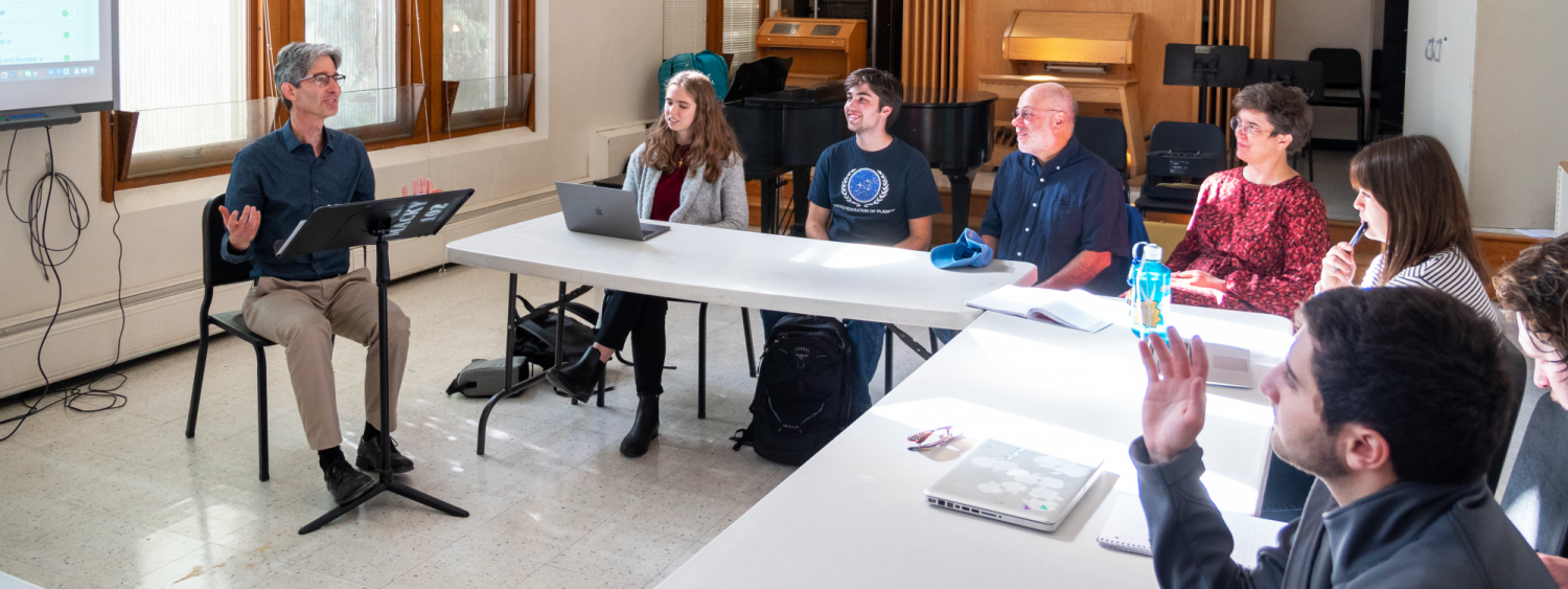 Professor Yonatan Malin (far left) teaching a group of students in on of his classes.
