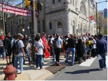 Protesters Prepare to Enter Temple's Town Hall Meeting