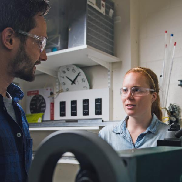 Greg Formosa and Rachel Wilmoth working in the fabrication room
