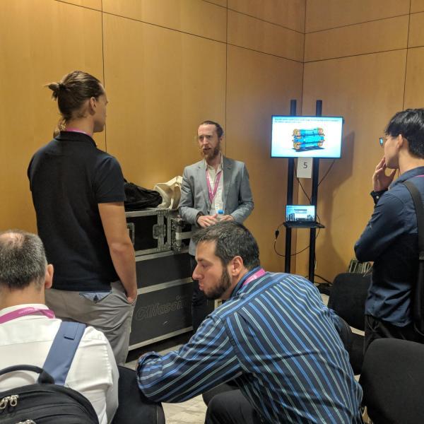 Micah Prendergast presenting at IROS 2018