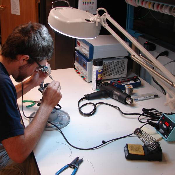 Levin working on electronics assembly.