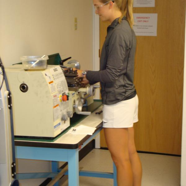 Madie fabricating a mobile crawler device for surgical applications.