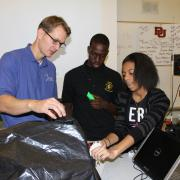 Ben Terry working with students using a surgical simulator