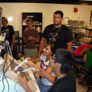 CU's Engineering Success Institute with students practicing their surgical skills using surgical trainers