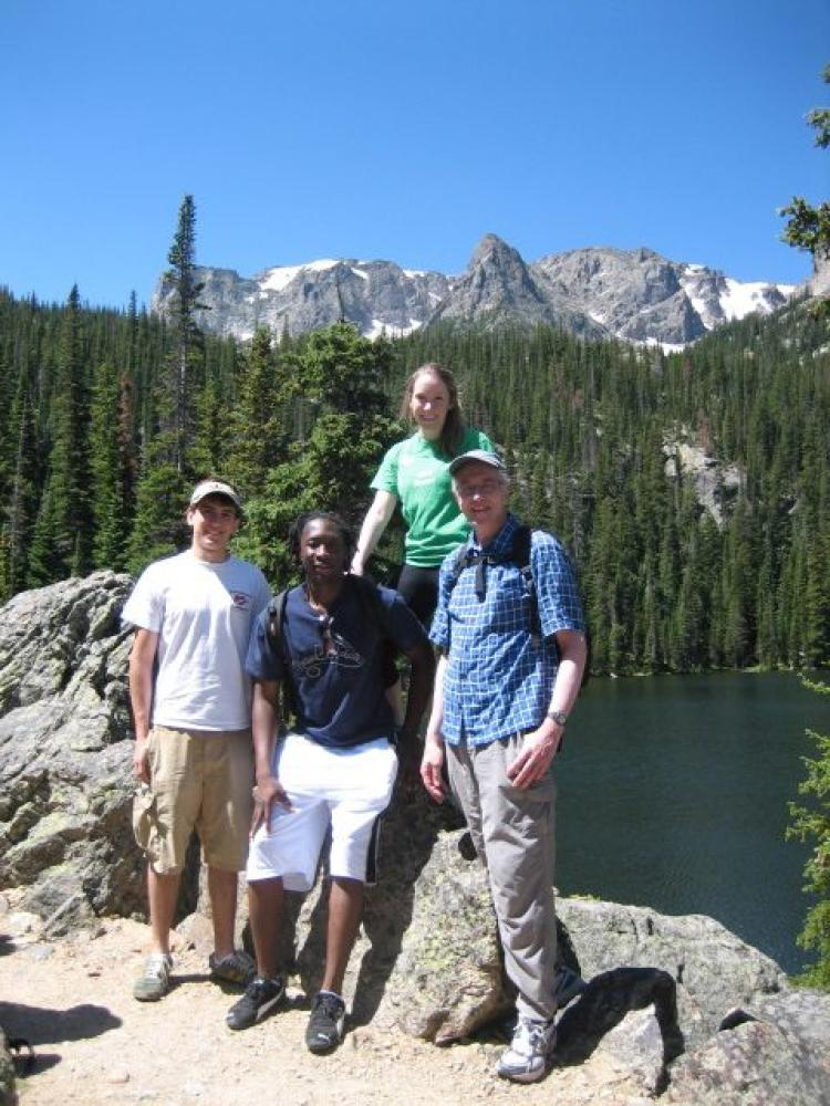Lab member with Tom Cech in front of a lake