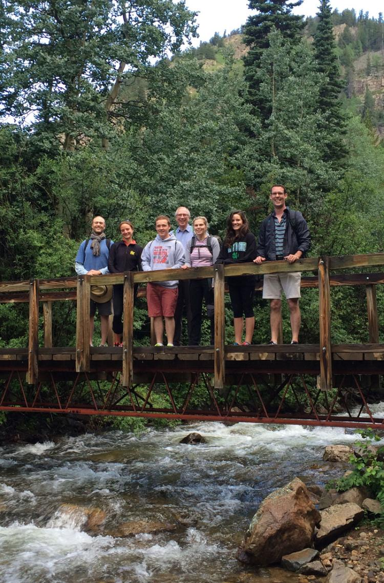Lab group on a bridge over a river
