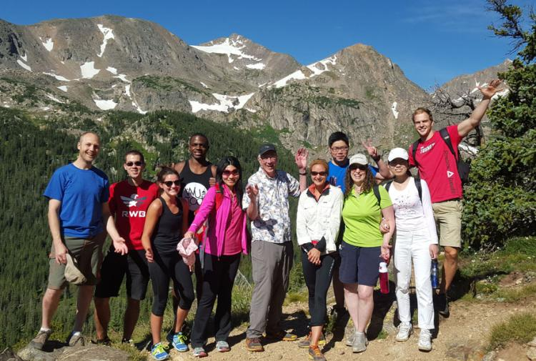 The lab group in front of mountains