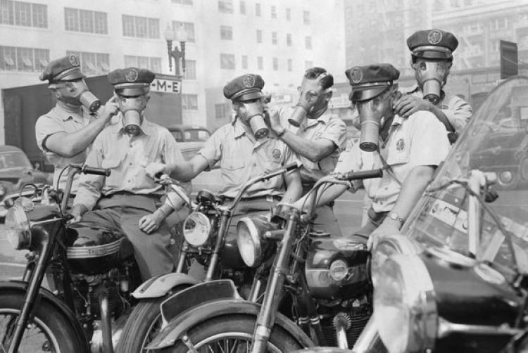 Old picture of people wearing gas masks