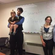 Orion with his family celebrating a successful defense