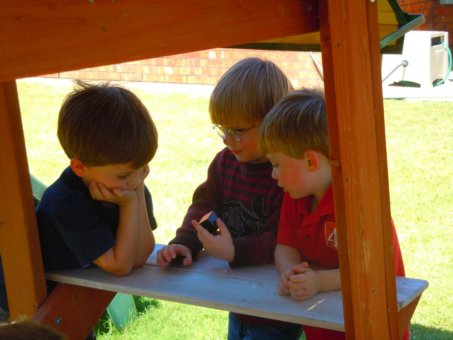 boys huddled on the playground