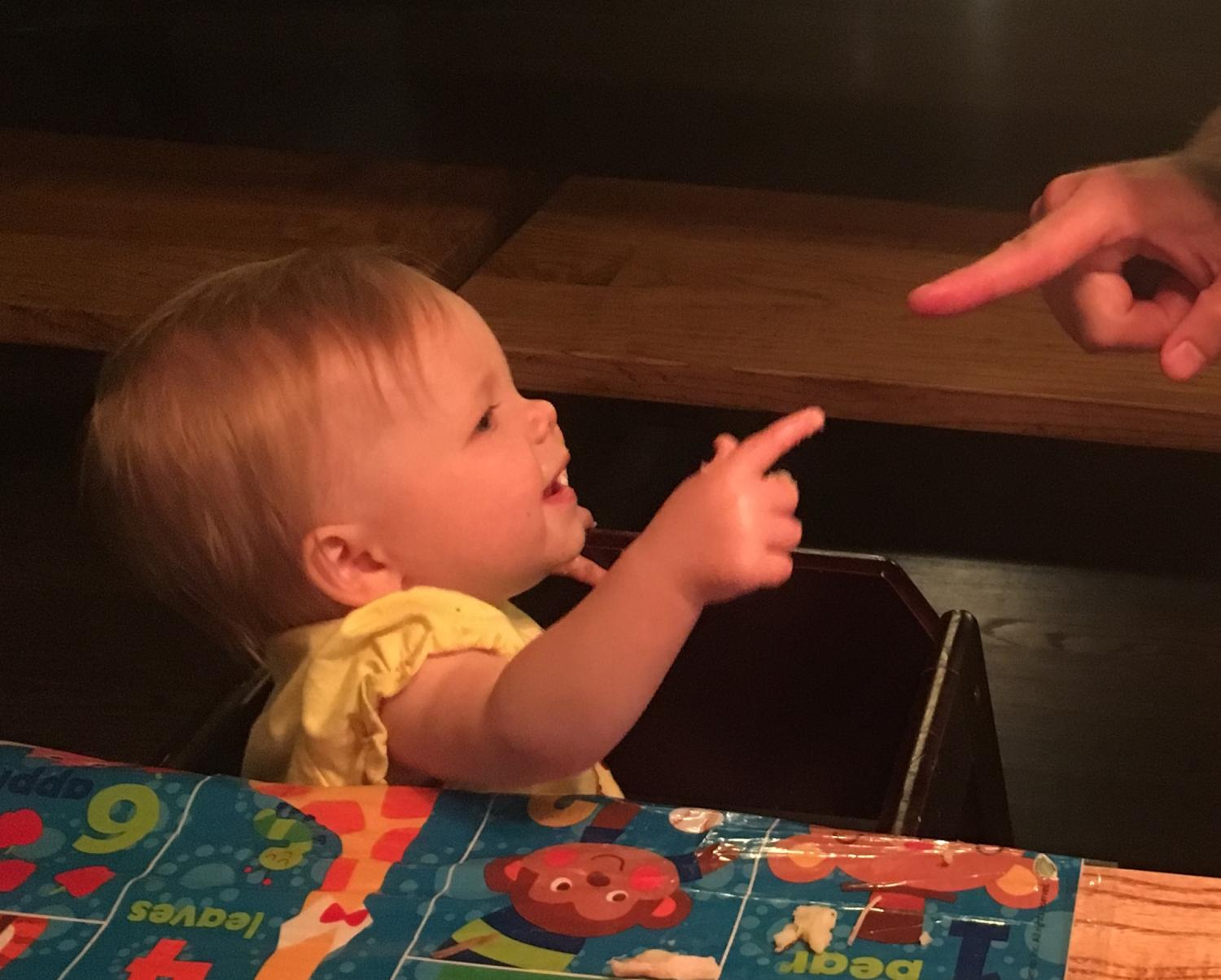 baby pointing at finger