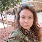 Erica with her favorite snake