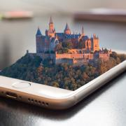 Castle emerging from a smartphone screen, via https://pxhere.com/en/photo/1168447.