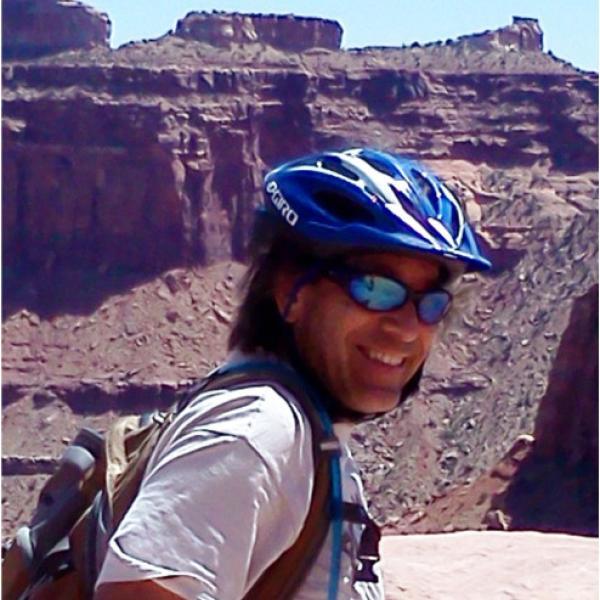 Chris Link with bike in desert