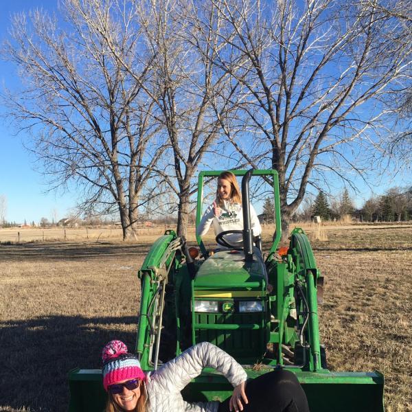Nicole posing in the tractor bucket