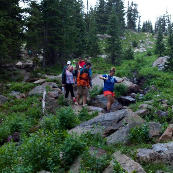 Nicole and lab members crossing the creek