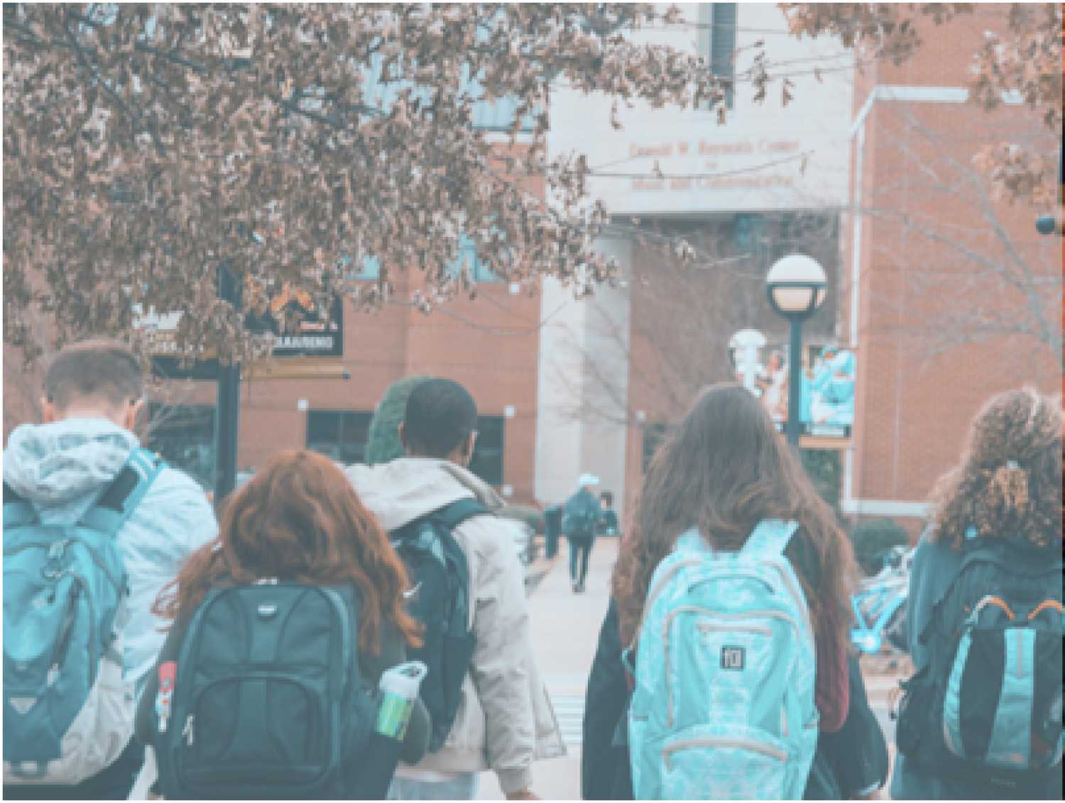 Students with backpacks walking