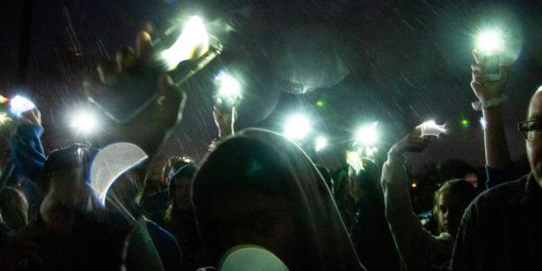 teens holding phones in the air, Kevin J. Beaty - Denverite
