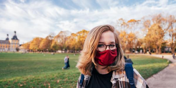 Girl wearing a face mask on campus