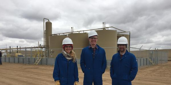 Greg Rieker and students on site at storage tank facilities
