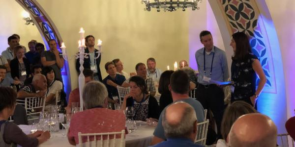 Greg Rieker receiving the Peter Werle award at a gala