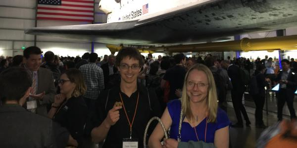 Amanda and Nate in front of a NASA space shuttle
